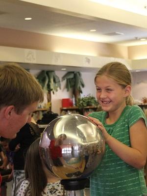 kid holding sphere